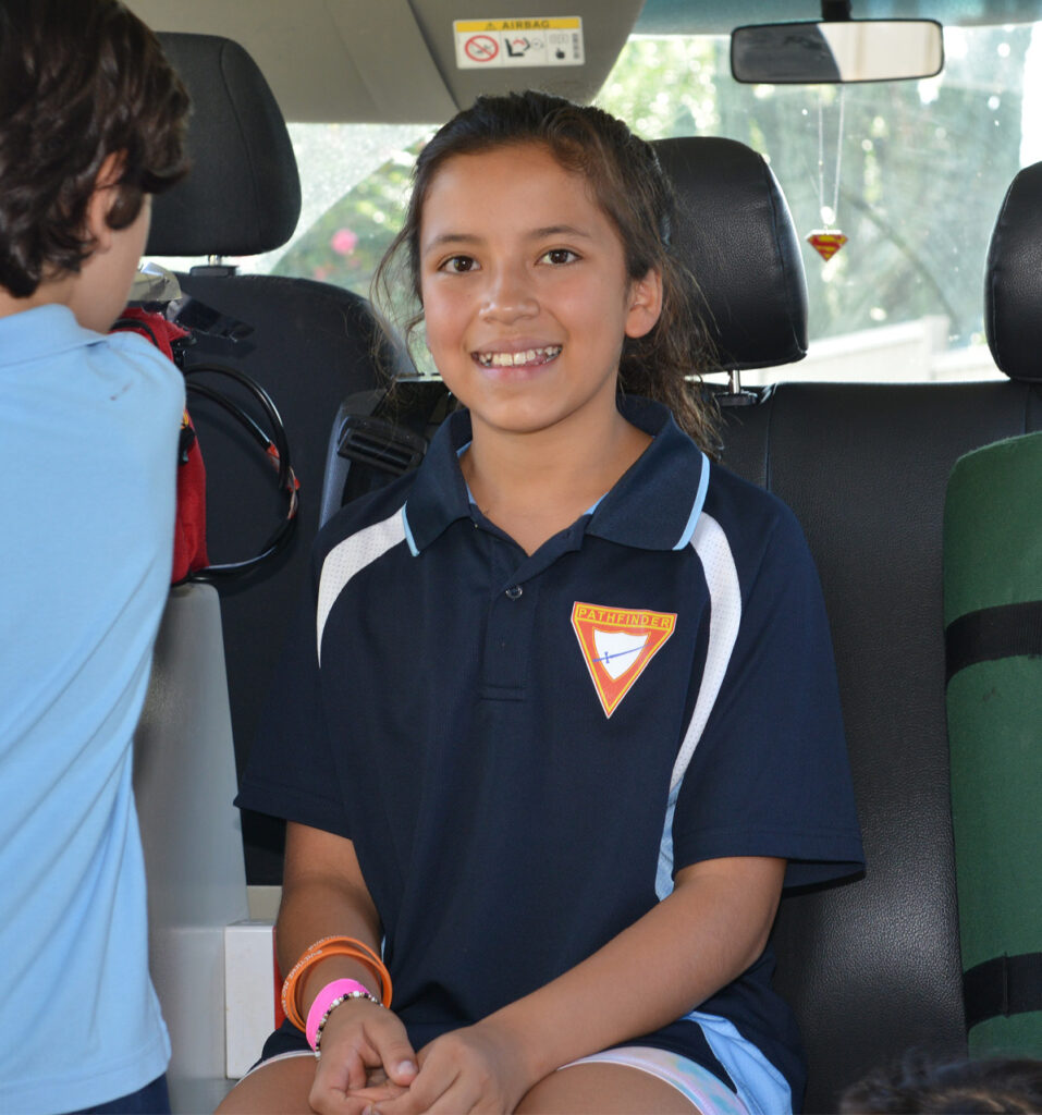A girl smiling in the NPT vehicle